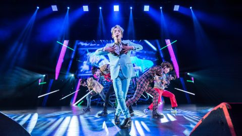 """Kim Ki Bum, known as """"Key,"""" sings in the front of the rest of the SHINee band in Dallas."""