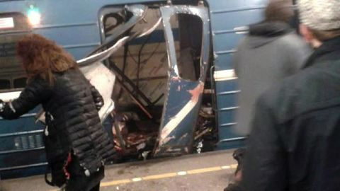 The damaged door of a train car is seen after an explosion on the subway in St. Petersburg, Russia, on Monday, April 3. Multiple people were killed in the blast.