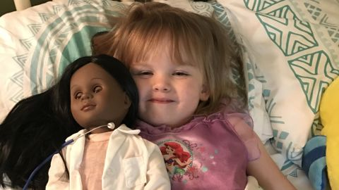 Sophia Benner, 2, with her new playmate.