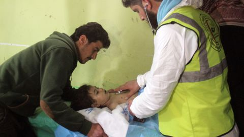 An unconscious Syrian child receives treatment at a hospital in Khan Sheikhun, a rebel-held town in the northwestern Syrian Idlib province, following a suspected toxic gas attack on April 4, 2017.  A suspected chemical attack killed at least 58 civilians including several children in rebel-held northwestern Syria, a monitor said, with the opposition accusing the government and demanding a UN investigation. / AFP PHOTO / Omar haj kadour        (Photo credit should read OMAR HAJ KADOUR/AFP/Getty Images)