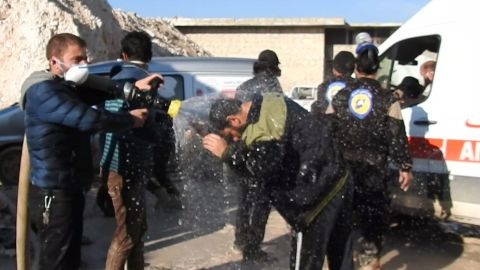Civil defense workers try to reduce the effects of toxic gas as they carry out search-and-rescue missions in Khan Sheikhoun.