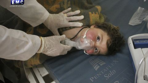 This photo provided Tuesday, April 4, 2017 by the Syrian anti-government activist group Edlib Media Center, which has been authenticated based on its contents and other AP reporting, shows a Syrian doctor treating a child following a suspected chemical attack, at a makeshift hospital, in the town of Khan Sheikhoun, northern Idlib province, Syria.
