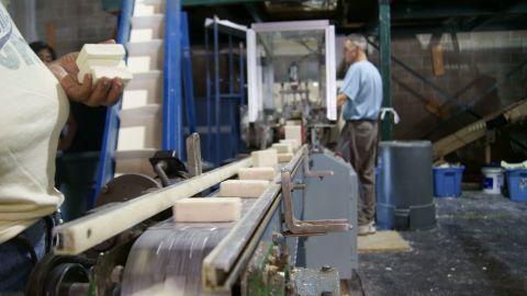 Freshly recycled soap rolls off the line at Clean the World's Orlando recycling center.