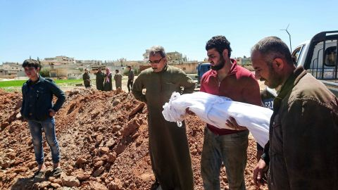 Syrians bury the bodies of victims of a a suspected toxic gas attack in Khan Sheikhun, a nearby rebel-held town in Syrias northwestern Idlib province, on April 5, 2017.International outrage is mounting over a suspected chemical attack that killed scores of civilians in Khan Sheikhun on April 4, 2017. Warplanes had carried out a suspected toxic gas attack that killed dozens people including several children, a monitoring group said. The Syrian Observatory for Human Rights said those killed in the town of Khan Sheikhun, in Idlib province, had died from the effects of the gas, adding that dozens more suffered respiratory problems and other symptoms. / AFP PHOTO / FADI AL-HALABI        (Photo credit should read FADI AL-HALABI/AFP/Getty Images)