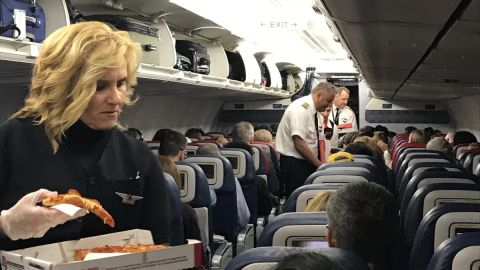 Crew members delivered pizza to stranded Delta customers Wednesday.
