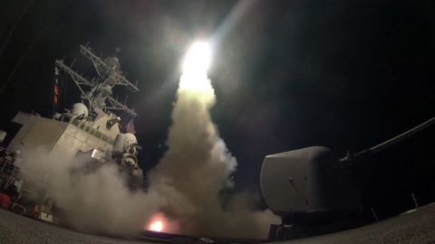 In this image provided by the U.S. Navy, the guided-missile destroyer USS Porter (DDG 78) launches a tomahawk land attack missile in the Mediterranean Sea, Friday, April 7, 2017. The United States blasted a Syrian air base with a barrage of cruise missiles in fiery retaliation for this week's gruesome chemical weapons attack against civilians.  (Mass Communication Specialist 3rd Class Ford Williams/U.S. Navy via AP)