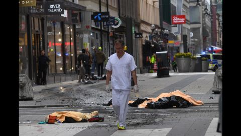 A medical responder moves through the scene of the attack.