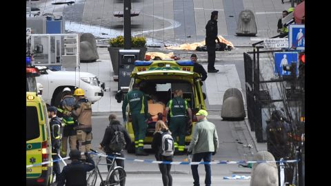 Emergency services work at the scene where a truck crashed into the Ahlens department store at Drottninggatan in central Stockholm, April 7, 2017.  / AFP PHOTO / TT NEWS AGENCY AND TT News Agency / Fredrik SANDBERG / Sweden OUT        (Photo credit should read FREDRIK SANDBERG/AFP/Getty Images)