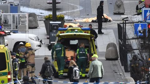 An injured person is put in an ambulance.