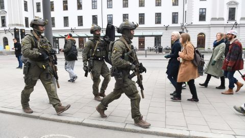Police officers secure the area outside the Stockholm Central train station. Parliament and the Stockholm subway were placed on lockdown.
