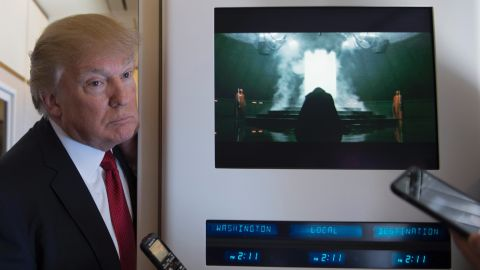"""US President Donald Trump speaks to the press on Air Force One on April 6, 2017.Chinese President Xi Jinping touched down in Florida Thursday for a first face-to-face meeting with President Donald Trump, hoping that a basket full of """"tweetable"""" deals will help avoid a public clash.Trump had yet to arrive to Florida, but the pair will gather later at his Mar-a-Lago resort -- which the US president likes to call the """"Winter White House"""" -- for what promises to be a masterclass in studied informality. / AFP PHOTO / JIM WATSON        (Photo credit should read JIM WATSON/AFP/Getty Images)"""