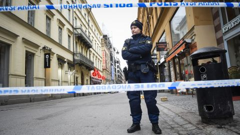 A police officer stands guard at the site of the attack.