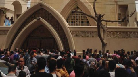 Relatives and onlookers gather outside St. George Coptic church after a bomb attack in the Nile Delta town of Tanta, Egypt, Sunday, April 9, 2017. The attack took place on Palm Sunday, the start of the Holy Week leading up to Easter.