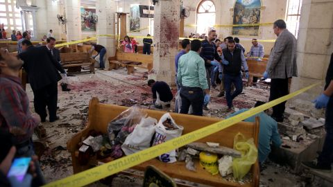 Security personnel survey the scene of a bomb blast at St. George's Church in Tanta, Egypt, on Palm Sunday.