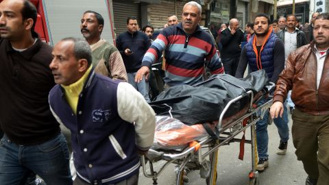 Rescue workers push a stretcher with a victims of a bomb explosion outside the Saint Mark's coptic Cathedral in Alexandria, Egypt on April 9.
