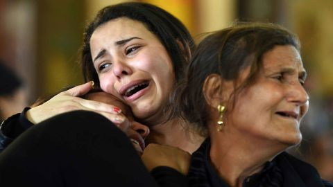 Women mourn for the victims of the blast at the Coptic Christian Saint Mark's church in Alexandria the previous day during a funeral procession at the Monastery of Marmina in the city of Borg El-Arab, east of Alexandria, on April 10, 2017.Egypt prepared to impose a state of emergency after jihadist bombings killed dozens at two churches in the deadliest attacks in recent memory on the country's Coptic Christian minority. / AFP PHOTO / MOHAMED EL-SHAHED        (Photo credit should read MOHAMED EL-SHAHED/AFP/Getty Images)