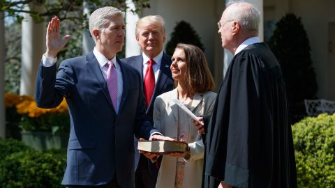 President Donald Trump watches as Supreme Court Justice Anthony Kennedy administers the judicial oath to Judge Neil Gorsuch during a re-enactment in the Rose Garden of the White House, Monday, April 10, 2017, in Washington. Gorsuch's wife Marie Louise hold a bible at center. (AP Photo/Evan Vucci)