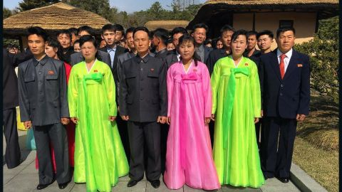 North Koreans pose on April 9, for a photo at Mangyongdae, the birthplace of Kim Il Sung.