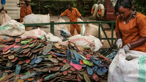 """""""Over three billion people can only afford that type of shoe,"""" says Erin Smith of Ocean Sole, a Kenyan conservation group and recycling collective, above pictured as they collect flip flops."""