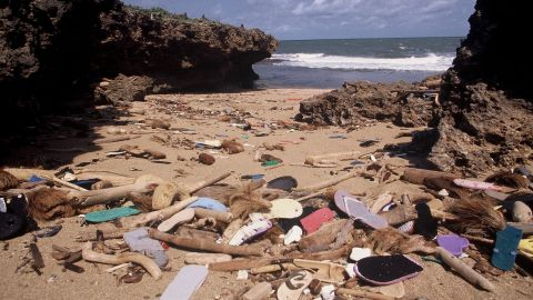 Each year, tons of flip flops wash up on the East African coast, including Kenyan beaches like the one pictured, posing a risk to plant and animal life.