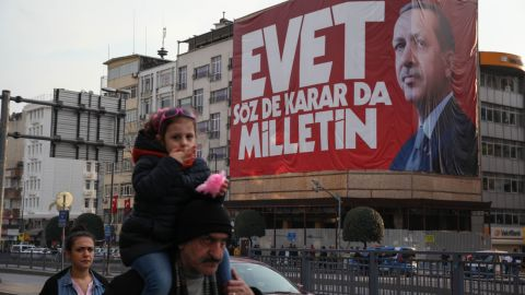 """Istanbul residents walk past """"Yes"""" campaign signs in the city center on Saturday, April 8, 2017.  President Tayyip Erdogan's """"Yes"""" campaign slogan reads: """"Yes. The people have the freedom to speak and decide."""" Large banners reading """"Evet,"""" or """"Yes"""" can be seen on virtually every corner of the city."""