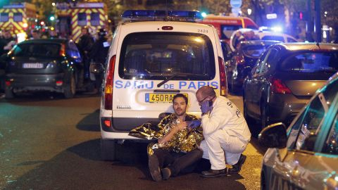 PARIS, FRANCE - NOVEMBER 13:  A medic tends to a man November 13, 2013 in Paris, France. Gunfire and explosions in multiple locations erupted in the French capital with early casualty reports indicating at least 60 dead. (Photo by Thierry Chesnot/Getty Images)