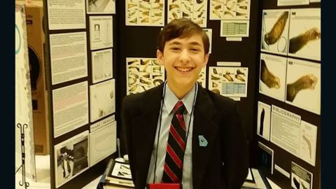 Stephen stands with his Georgia Science and Engineering Fair project in Powder Springs, Georgia.