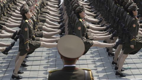 Female North Korean soldiers march during the parade.
