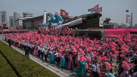 A rocket-themed float makes its way through Kim Il-Sung square.