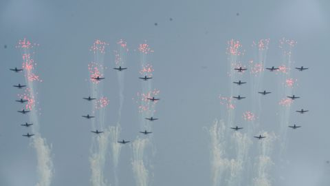 North Korean air force jets fly over the Pyongyang celebration.