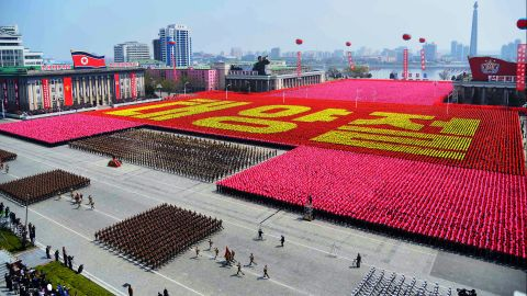 """Korean citizens spell out """"Day of the Sun"""" in Kim Il Sung Square."""