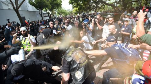 A man gets sprayed with a chemical irritant as multiple fights break out between Trump supporters and anti-Trump protesters in Berkeley, California on April 15, 2017.