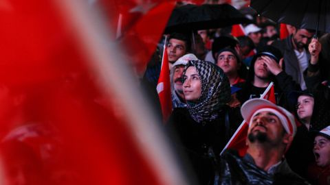 """Turks celebrate at AKP headquarters in Ankara as the early results indicate a win for the """"yes"""" ballots."""