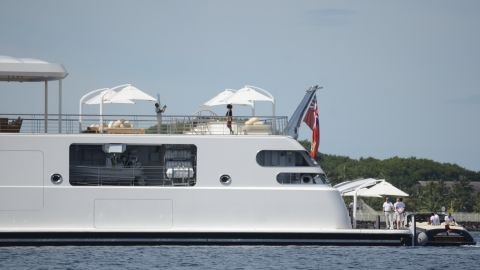 Former US President Obama take a holiday snap of his wife Michelle, as she poses on the top deck of the 138 meter Rising Sun yacht where the couple and friends spent the morning off the Island of Moorea, in the South Pacific, part of French Polynesia on April 14, 2017.
