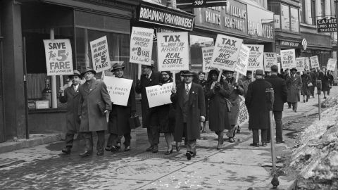 """(Original Caption) 3/9/1948-Albany, NY- """"Equal Rights Day"""" pickets march from Albany's Union Station to the state capitol to press for anti-discrimination legislation, retention of the five-cent New York subway fare, and a return of the nickel beer. The delegation included representatives of the Communist Party, the American Labor Party, the NAACP, the PCA and others."""