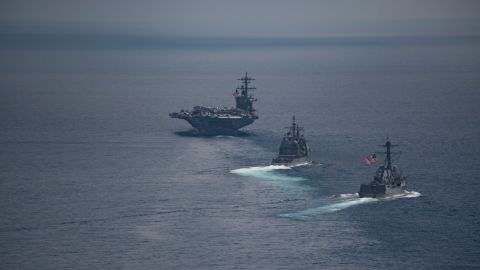 The aircraft carrier USS Carl Vinson leads the guided-missile destroyer USS Michael Murphy and the guided-missile cruiser USS Lake Champlain in the Indian Ocean on April 14.