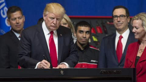 US President Donald Trump signs a Buy American, Hire American Executive Order at Snap-On Tools in Kenosha, Wisconsin, April 18, 2017. / AFP PHOTO / SAUL LOEB        (Photo credit should read SAUL LOEB/AFP/Getty Images)
