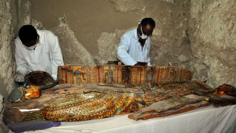 TOPSHOT - Members of an Egyptian archaeological team work on a wooden coffin discovered in a 3,500-year-old tomb in the Draa Abul Nagaa necropolis, near the southern Egyptian city of Luxor, on April 18, 2017.Egyptian archaeologists have discovered six mummies, colourful wooden coffins and more than 1,000 funerary statues in the 3,500-year-old tomb, the antiquities ministry said. / AFP PHOTO / STRINGER        (Photo credit should read STRINGER/AFP/Getty Images)
