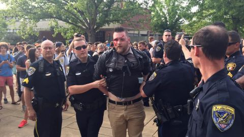 A protestor is arrested after a fight at Auburn University's Foy Hall on Tuesday, April 18.