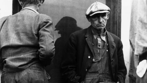 Unemployed men wait for a relief check in Imperial Valley, California, during the Great Depression.