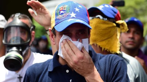 Opposition leader Henrique Capriles reacts to tear gas during a protest on April 19.