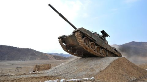 """This undated picture released from North Korea's official Korean Central News Agency (KCNA) on April 1, 2017 shows the Korean People's Army Tank Crews' Competition-2017 at an undisclosed location. / AFP PHOTO / KCNA VIA KNS / STR / South Korea OUT / REPUBLIC OF KOREA OUT   ---EDITORS NOTE--- RESTRICTED TO EDITORIAL USE - MANDATORY CREDIT """"AFP PHOTO/KCNA VIA KNS"""" - NO MARKETING NO ADVERTISING CAMPAIGNS - DISTRIBUTED AS A SERVICE TO CLIENTS THIS PICTURE WAS MADE AVAILABLE BY A THIRD PARTY. AFP CAN NOT INDEPENDENTLY VERIFY THE AUTHENTICITY, LOCATION, DATE AND CONTENT OF THIS IMAGE. THIS PHOTO IS DISTRIBUTED EXACTLY AS RECEIVED BY AFP.  /         (Photo credit should read STR/AFP/Getty Images)"""