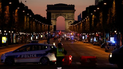 Police officers block the access to the Champs Elysees in Paris after a shooting on April 20, 2017.One police officer was killed and another wounded today in a shooting on Paris's Champs Elysees, police said just days ahead of France's presidential election. France's interior ministry said the attacker was killed in the incident on the world famous boulevard that is popular with tourists. / AFP PHOTO / Ludovic MARIN        (Photo credit should read LUDOVIC MARIN/AFP/Getty Images)