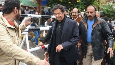 Pakistani opposition leader Imran Khan (C), whose party runs Khyber Pakhtunkhua province, welcomed the new regime governing the tribal areas.