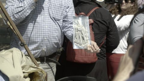 DCMJ co-founder Adam Eidinger holds a bag of joints prior to being arrested.