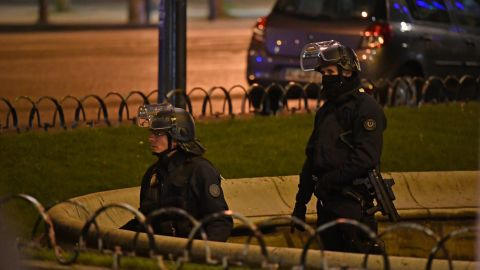 PARIS, FRANCE - APRIL 20:  Police officers secure the area after a gunman opened fire on Champs Elysees on April 20, 2017 in Paris, France. One police officer has been killed, and a second injured by a gunman on The Champs Elysees. Security is heightened in Paris with the first round of France's presidential election on Sunday.   (Photo by Jeff J Mitchell/Getty Images)