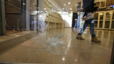 A damaged window is pictured on the Champs Elysees boulevard in Paris early Friday.