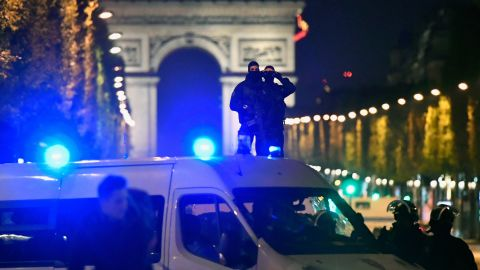 Police survey the Champs-Elysées as they work to secure the area.