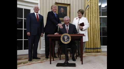 """Trump puts his hand on the shoulder of Secretary of State Rex Tillerson after <a href=""""http://www.cnn.com/2017/02/01/politics/tillerson-confirmation-vote-senate/"""" target=""""_blank"""">Tillerson was sworn in</a> on February 1. They are joined by Vice President Pence and Tillerson's wife, Renda St. Clair. Tillerson, a former CEO of ExxonMobil, was <a href=""""http://www.cnn.com/2017/02/01/politics/tillerson-confirmation-vote-senate/"""" target=""""_blank"""">confirmed in the Senate </a>by a vote of 56 to 43."""