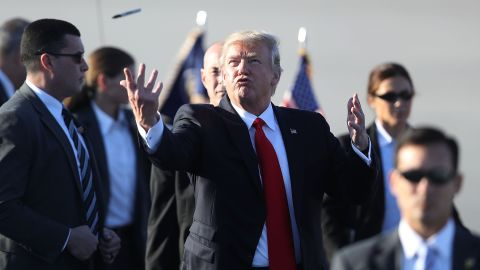 """Trump tosses a Sharpie pen back to a group of supporters after signing autographs in Palm Beach, Florida, on Friday, February 3. Trump was spending the weekend at his Mar-a-Lago resort, which has become <a href=""""http://www.cnn.com/2017/04/14/politics/donald-trump-north-korea-mar-a-lago/"""" target=""""_blank"""">a popular trip</a> so far during his presidency."""